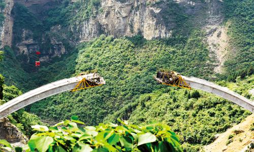 鸡鸣三省大桥加快推进 主拱圈7月合龙