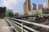 泸州主城区五座人行天桥本月全部投用  正进行扫尾工作